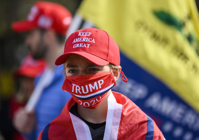 Supporters of US president Donald Trump look on in front of the White House as they gather near counter protesters in Washington, DC on November 13, 2020.