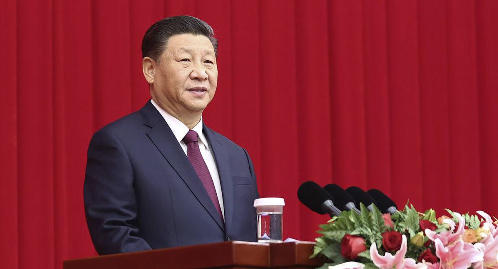 习近平:天问一号探测器在火星上首次留下中国人的印迹