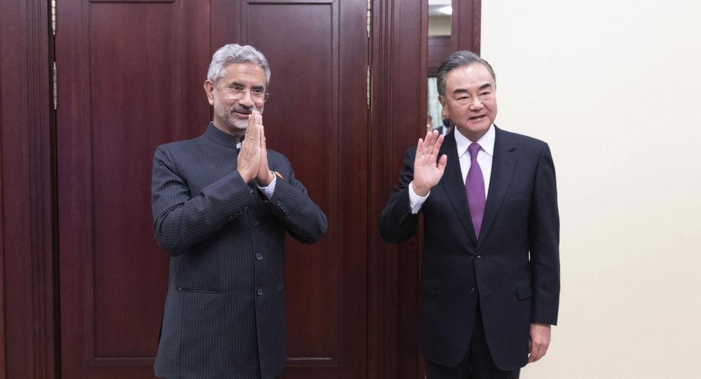 王毅與蘇傑生