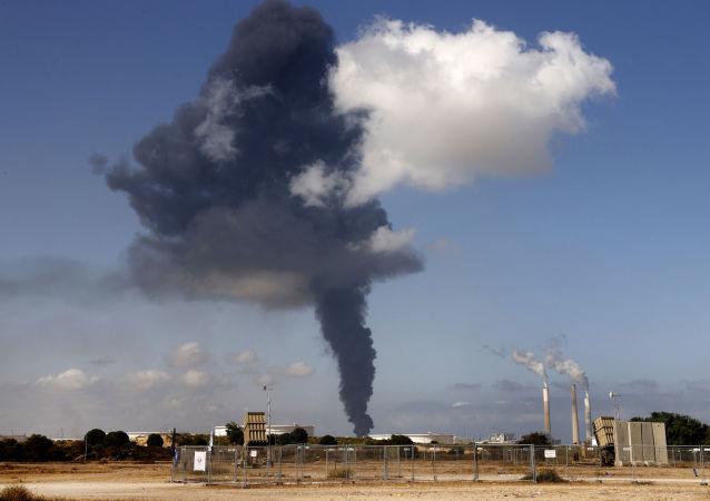 以色列軍方:以襲擊哈馬斯在加沙地帶的設施報復其發射火箭彈