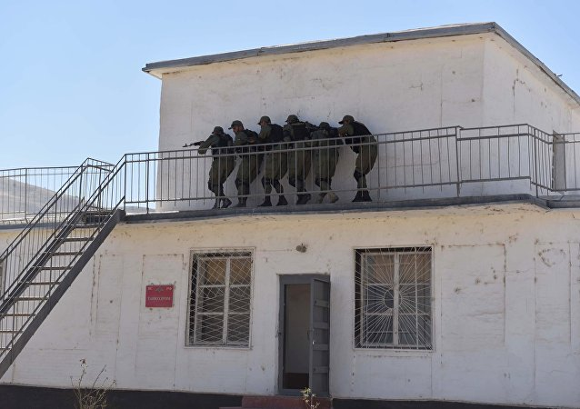 A simulated storming of a building during a combined exercise of the Russian military post 201 and military forces of Tajikistan