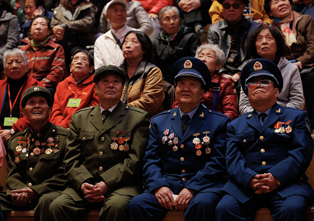 War veterans and local residents watch the opening of the 19th Communist Party Congress on television at a bookstore in Shenyang