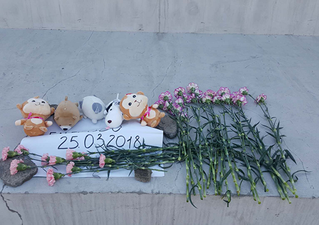 哈尔滨俄侨举行活动悼念克麦罗沃火灾遇难者