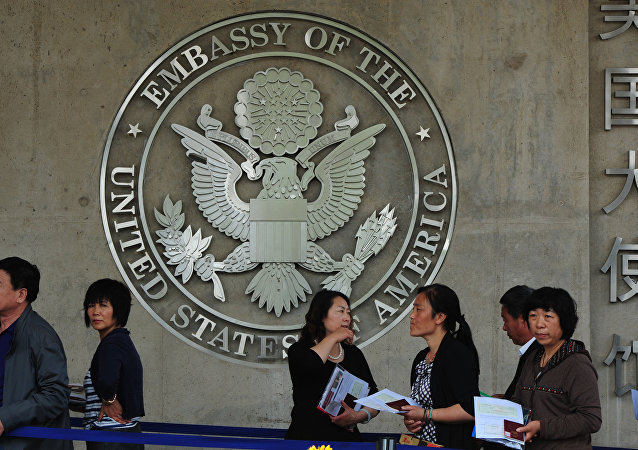 Chinese citizens wait to submit their visa applications at the US Embassy