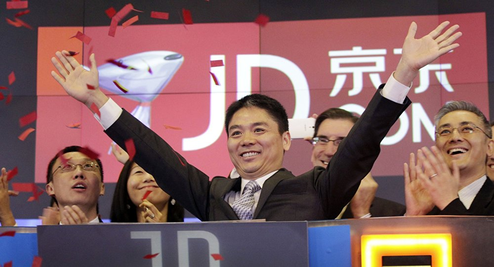 Liu Qiangdong, also known as Richard Liu, CEO of JD.com, raises his arms to celebrate the IPO for his company at the Nasdaq MarketSite, in New York