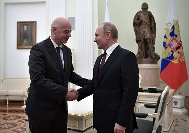 普京總統與國際足聯主席因凡蒂諾(資料圖片)
