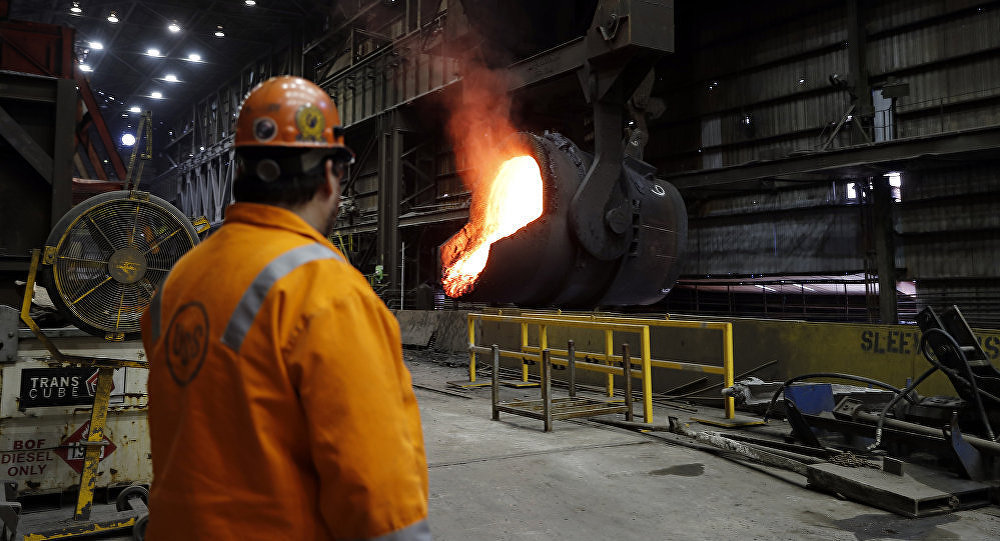 Senior melt operator Randy Feltmeyer watches a giant ladle as it backs away after pouring its contents of red-hot iron into a vessel in the basic oxygen furnace as part of the process of producing steel at the U.S. Steel Granite City Works facility in Granite City, Ill.