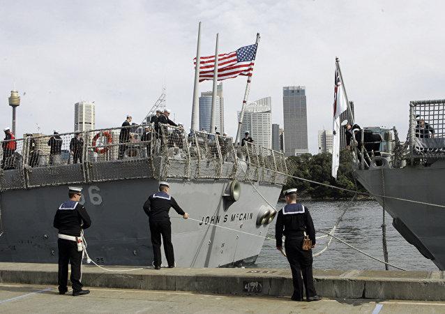 Australian sailors tie up the U.S. navy ship USS John S McCain (DDG-56) upon arrival in Sydney, Australia