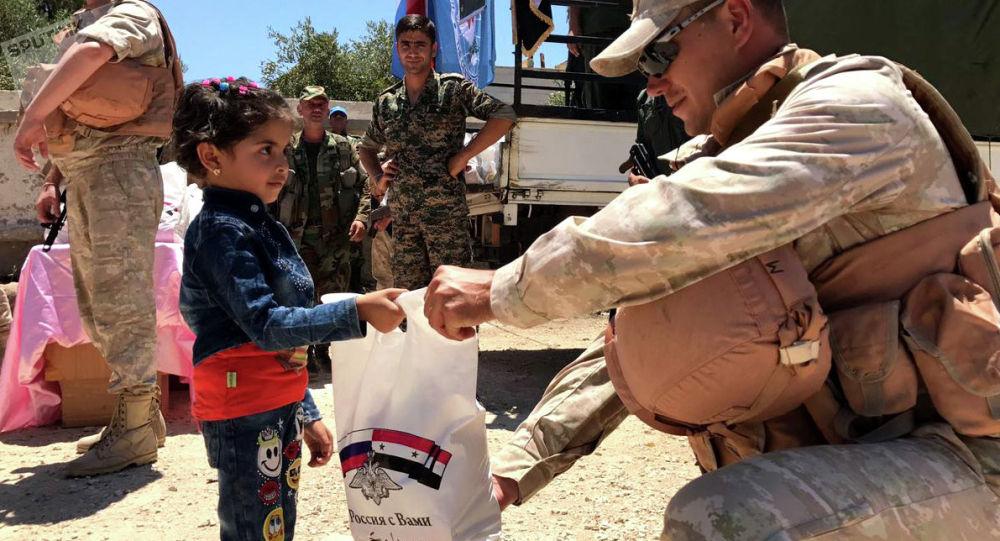 俄军已将人道主义救援物资运至叙利亚卡姆哈纳